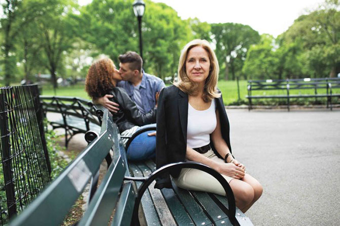 Helen on a Park Bench with a Romantic Couple in the Background