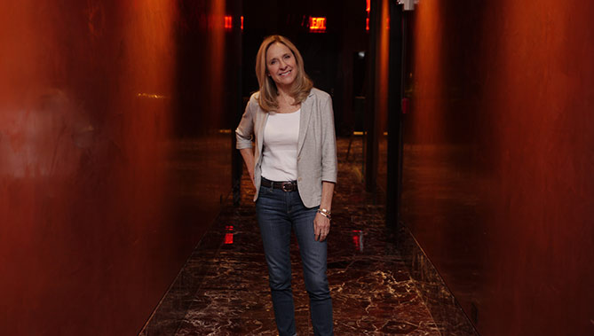 Helen Fisher in Red Hallway